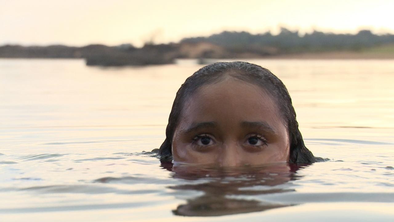 Girl in water.