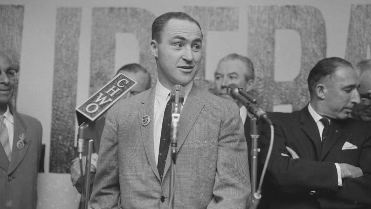 an archival photo of Red Kelly