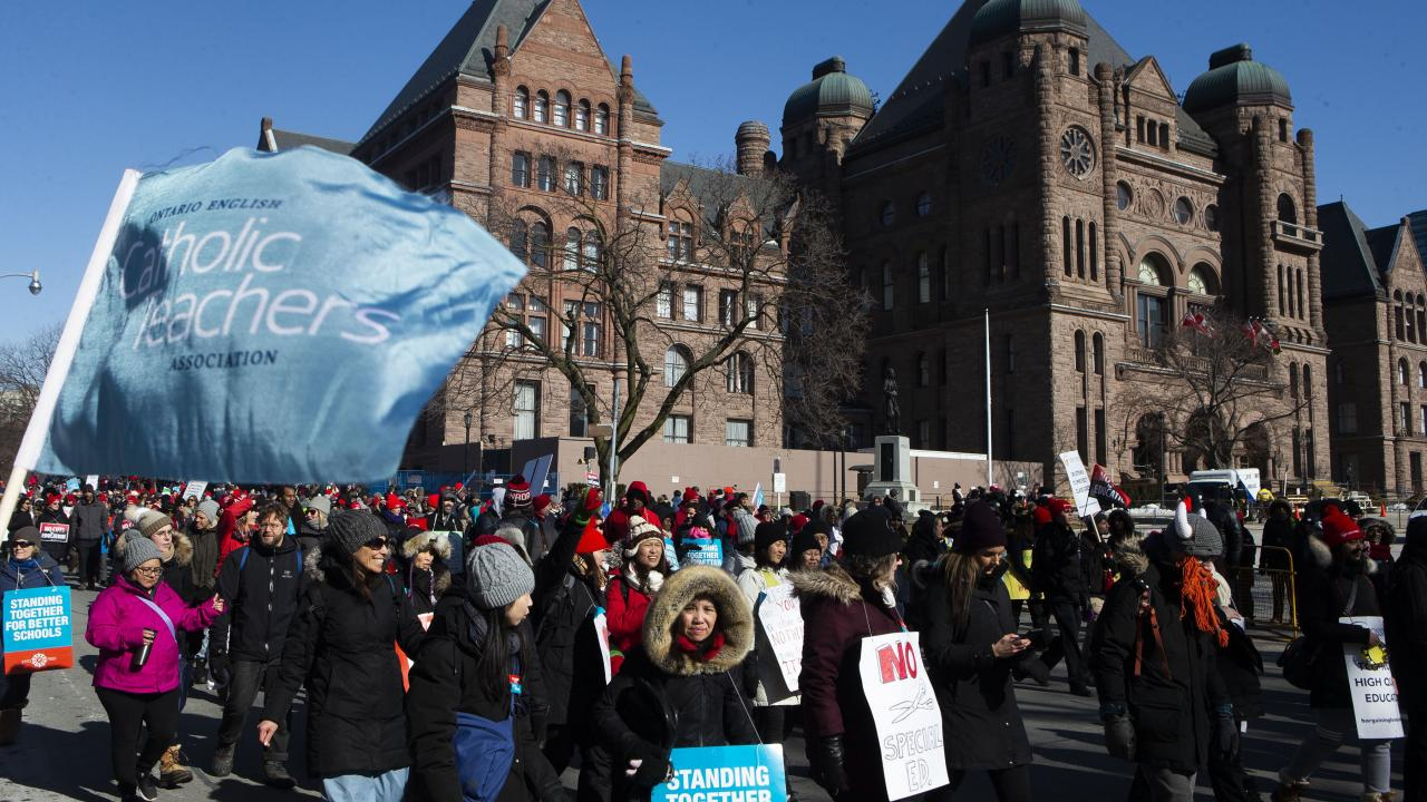 protesters outside Queen's Park