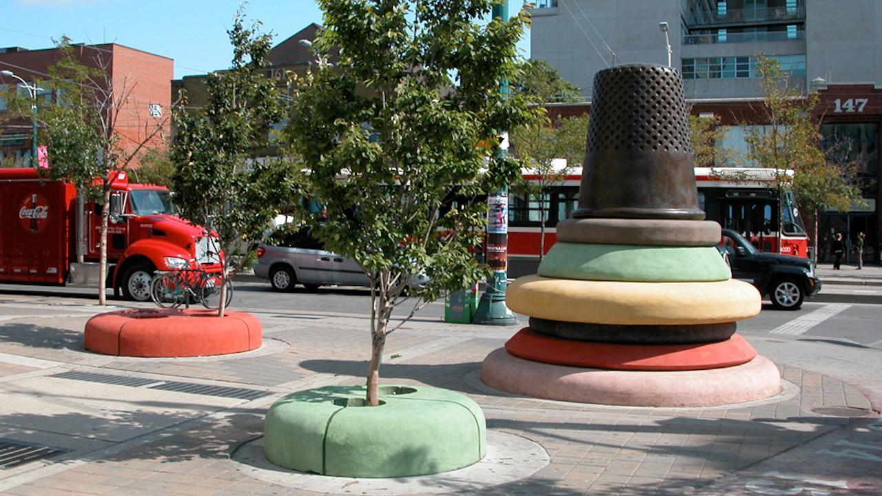 a giant thimble sculpture in a park