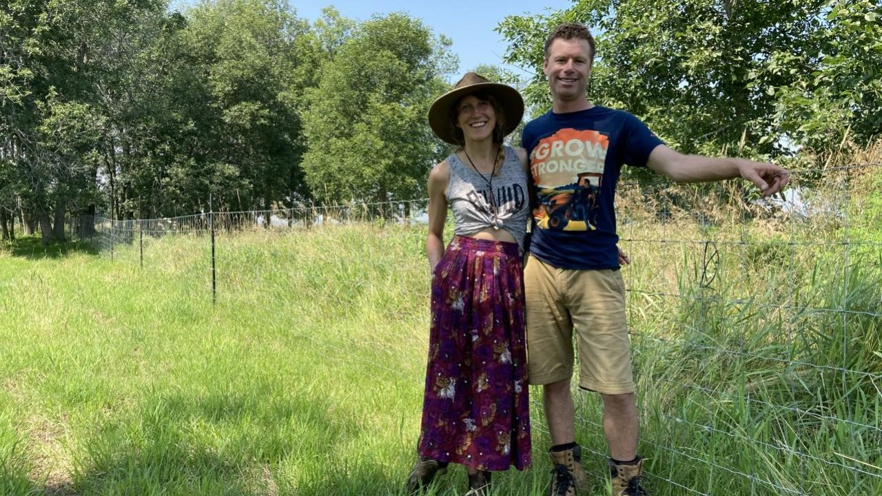 smiling man and woman in a field