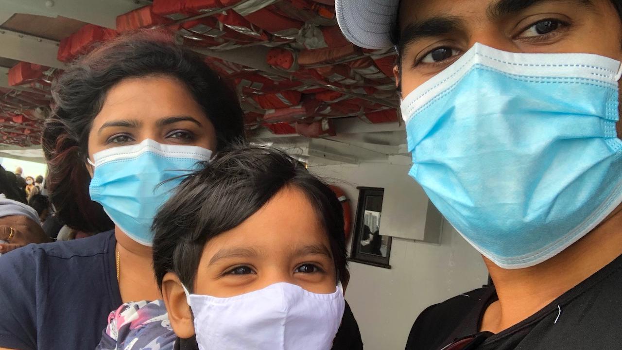 a man, woman, and child wearing masks