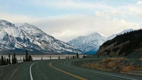 a stretch of the Alaska highway, with mountains in view