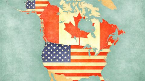 A map showing Canada and the United States. Canada is represented by a Canadian flag, the U.S. is represented by an American flag.
