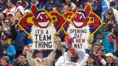 baseball fans holding up a sign in a stadium