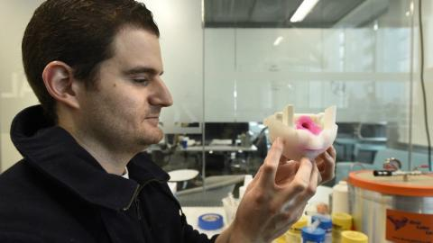 Medical researcher Dale Podolsky demonstrates his cleft palate practise model.