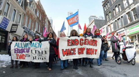 women protesting with placards