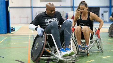 two people in wheelchairs in a competition