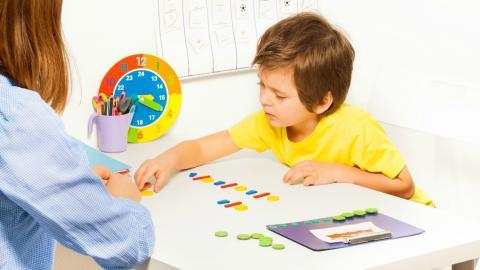 child at desk learning shapes