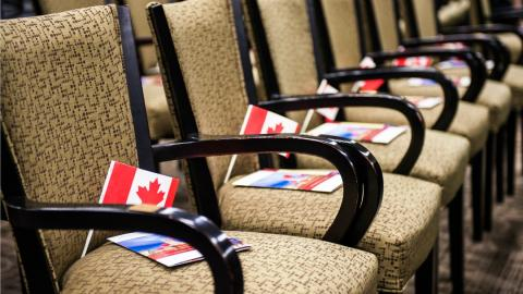 a row of chairs with Canadian flags on them