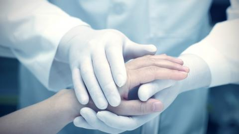 a doctor holding a patient's hand