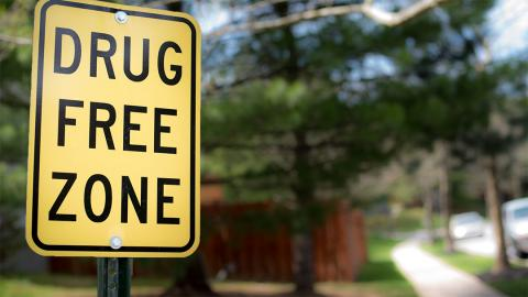 "a street sign that says, ""drug free zone"""