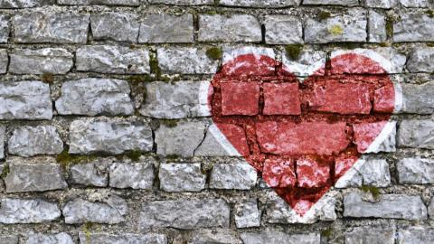 a heart painted on a brick wall