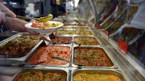 an buffet of various Indian foods