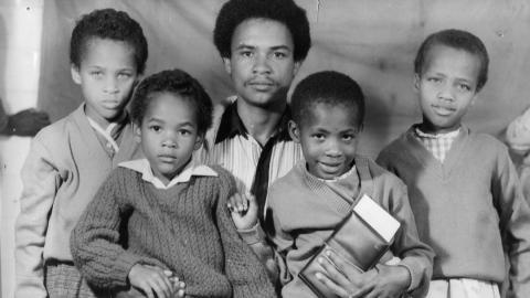 The author Nam Kiwanuka, left, with her family