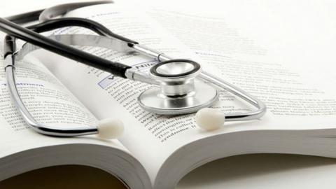 stethoscope and medical book