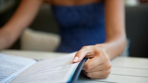 a woman reading a menu