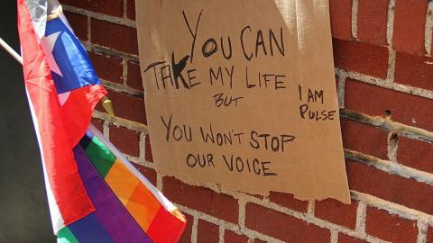 """a placard saying """"you can take my life but you can't stop my voice"""" on a sidewalk in New York"""