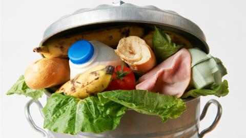 a garbage can full of discarded food