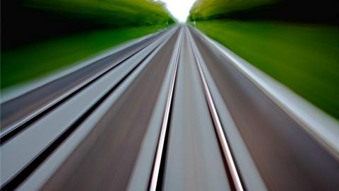 blurring of rail lines as a train passes