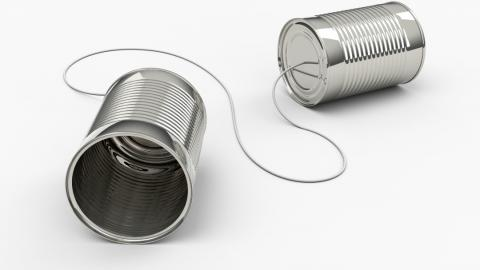 two tin cans connected by a string, representing communication