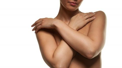 woman hiding chest with arms