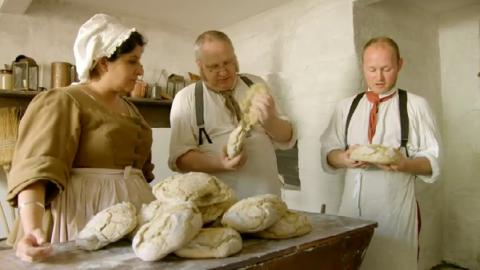 three victorian bakers making bread