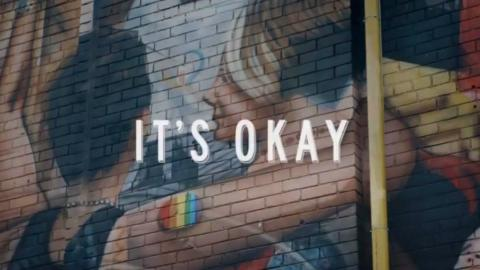 """an excerpt from a promotional video for Toronto showing two people hugging, saying """"It's Okay"""""""