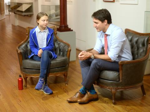 Liberal leader Justin Trudeau speaks Swedish with environmental activist Greta Thunberg in Montreal onSeptember 27, 2019.