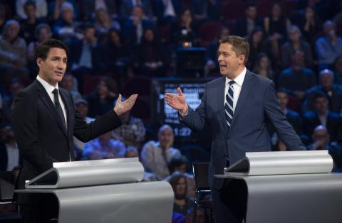 Liberal leader Justin Trudeau and Conservative leader Andrew Scheer debate a point during the federal leaders' debate in Gatineau, Quebec, on October 7.