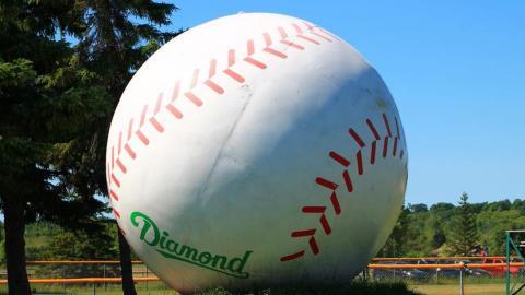 a giant baseball sculpture