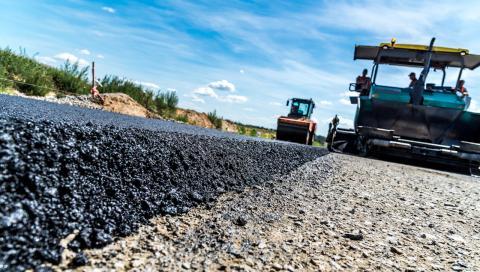 a machine repaving a road