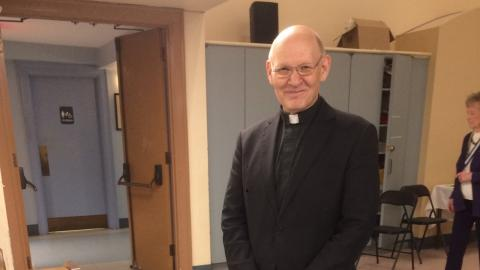 a man wearing a clerical collar