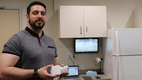 a man showing smart home devices