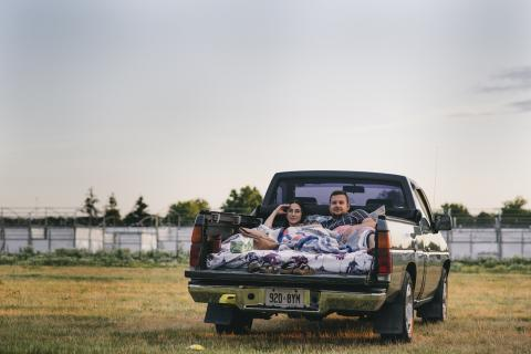 Couple in the back of a pickup truck