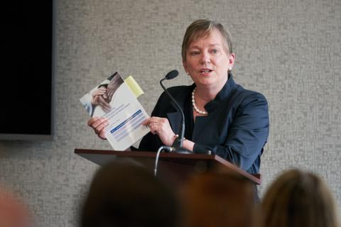 Justice Eileen E. Gillese holds up her final report
