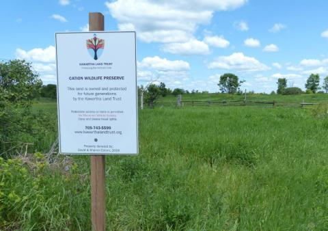 a sign that says Canadian Wildlife Reserve
