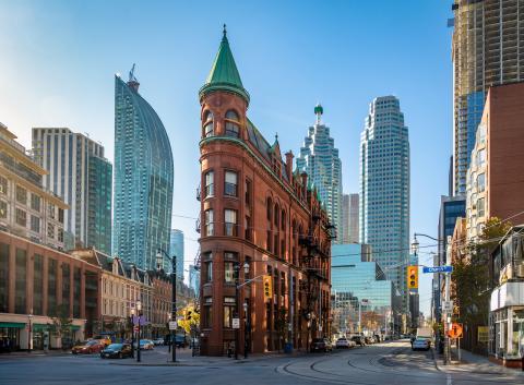 a downtown street with skyline