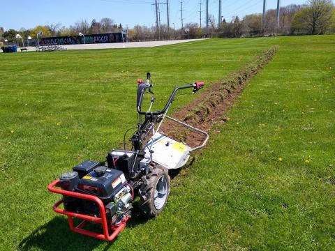a machine that's tilled a row for planting
