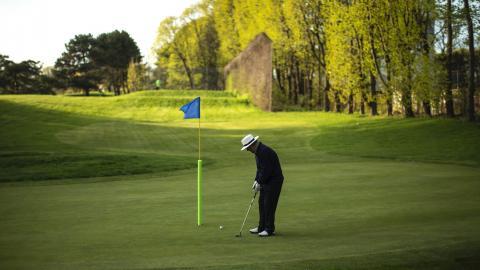 a man golfing on a green