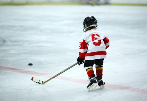 young child playing hockey