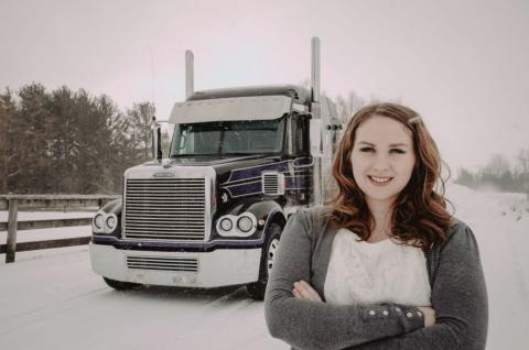 woman standing in front of truck