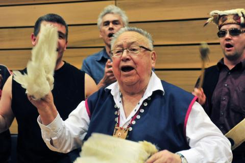 Indigenous men singing