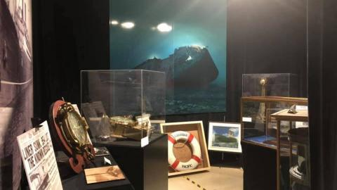 a room full of nautical objects and a photo of a ship