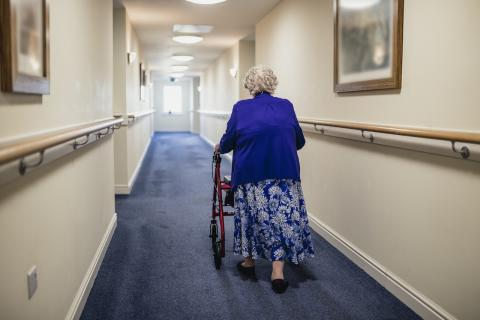 women with a walker in an LTC home