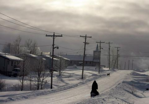 a person walking on a snow-packed road