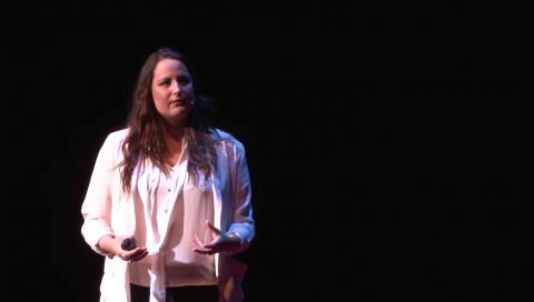 Tamara Bernard on stage delivering a TEDX talk