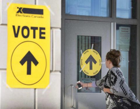 a woman entering a polling place during Canadian federal election