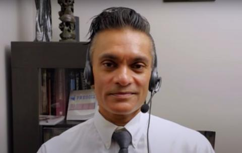 man wearing a headset and a tie