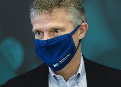 a man wearing a blue face mask